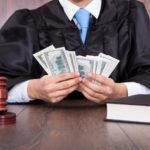 judge holding money